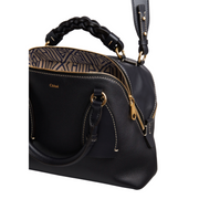 Black calfskin leather Chloé Daria bag in dark navy blue leather with shoulder strap and braided handle