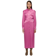 woman standing straight looking directly into the camera with arms by her sides wearing a midi length pink satin shirtdress with long sleeves.