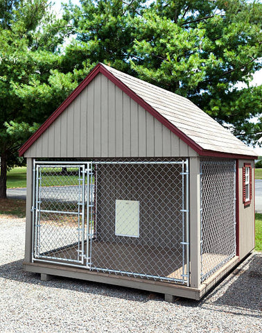 Large dog house with chain link door.