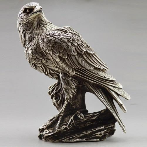White bronze sculptures - eagles and owls