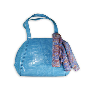 Shiny blue bag with scarf