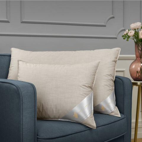 Lovely down pillows on armchair
