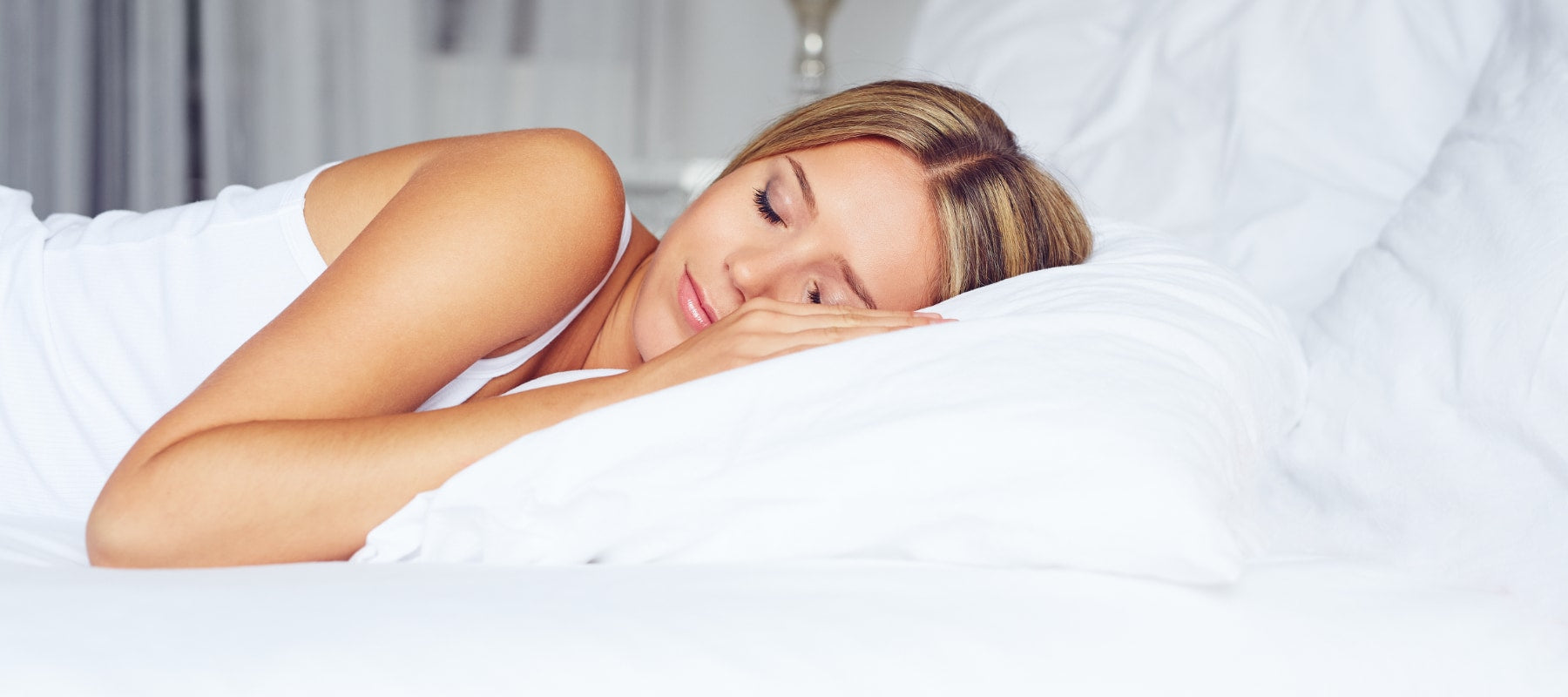 woman sleeping on Hungarian goose down pillows