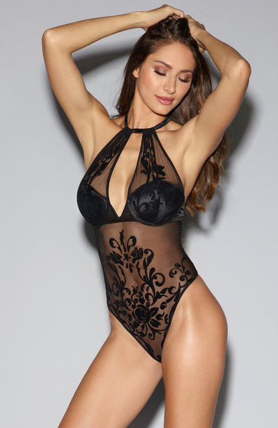 A black bodysuit in sheer mesh and flushed velvet rose vine embellishment with adjustable straps and plunge neckline