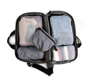 The Pakt One Packing Cube Set for the Pakt One Duffel includes 5 pieces: 2 large cubes, one small cube, a stuff sack, and a zippered pouch. The Packing cubes come in Red, Black, or Grey.