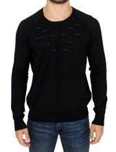 Black crewneck pullover sweater