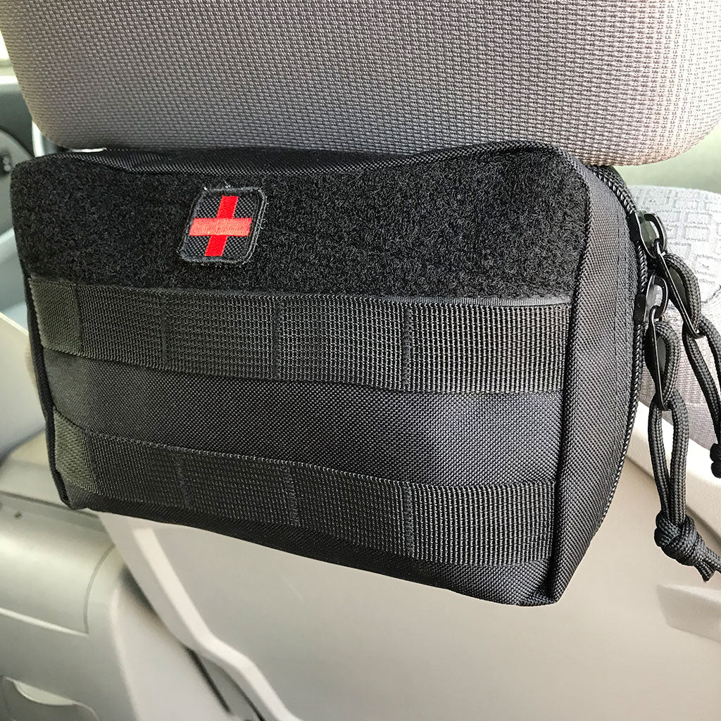 Black First Aid Kit Pouch attached to the back of a car seat