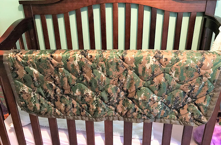 Woobie Blanket Poncho Liner drapped over crib