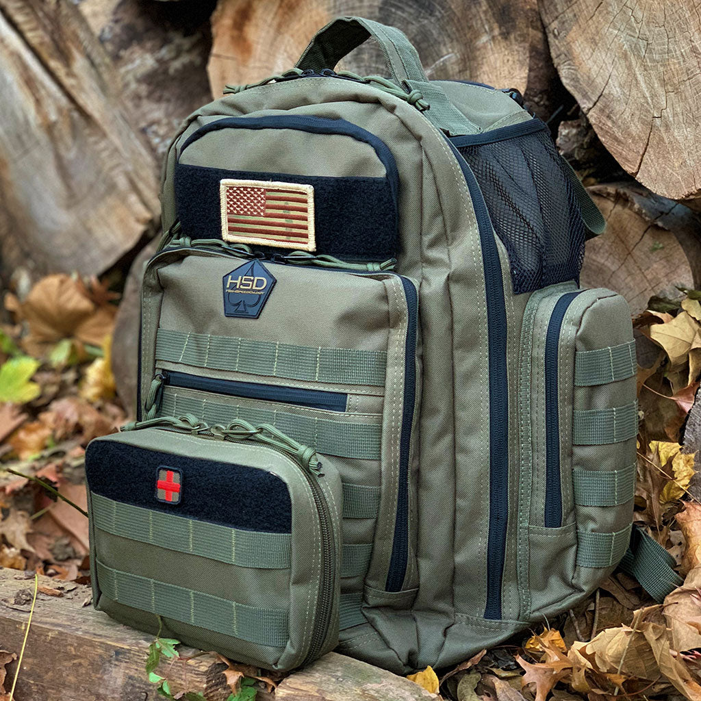 Ranger green First Aid Kit Pouch attached to a Diaper Bag Backpack