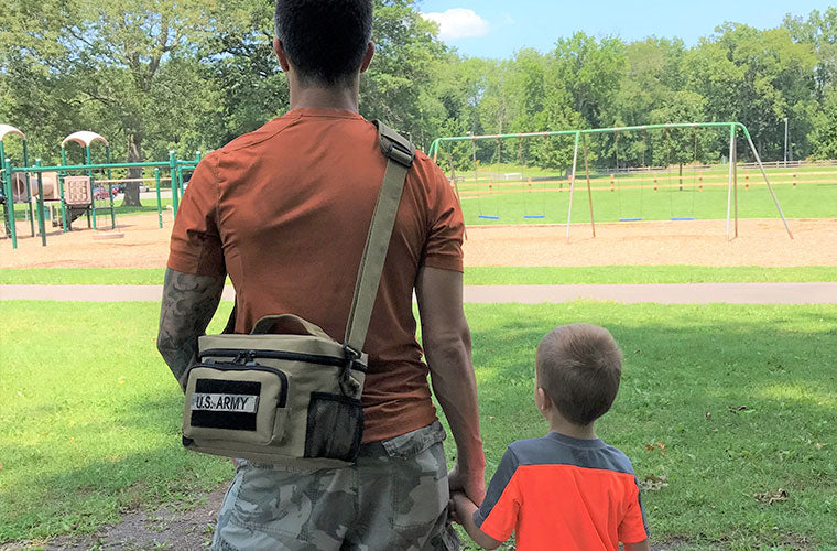 Man Carrying Tactical Lunch Bag with His Son