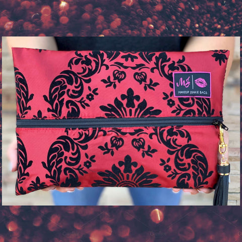 Makeup Junkie Bags Regal with Red background featuring fanciful black design Cosmetic Makeup Bag At Chic Picks