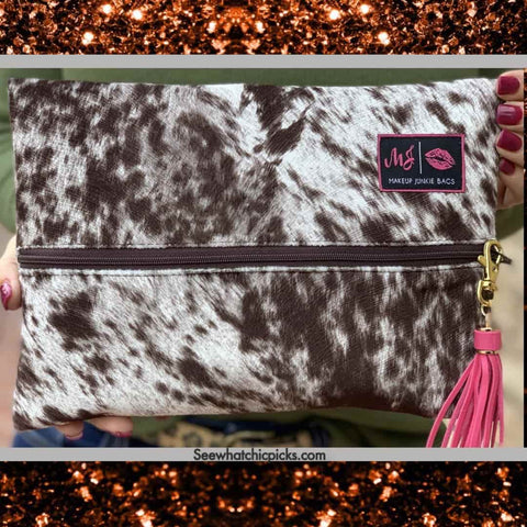 Makeup Junkie Bags Lola Chocolate Cow Print Cosmetic Bag Women's fashion cosmetic bags and accessories at chic Picks Boutique