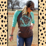 "The ""Fly Ball"" Animal Print Softball Graphic with Turquoise Baseball Sleeves."
