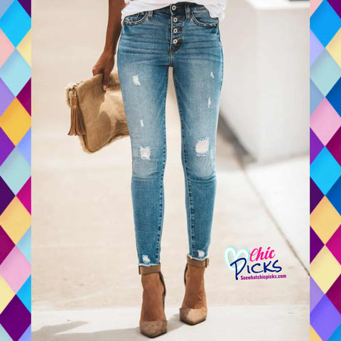 KanCan light wash mid rise skinny jeans with slight distressing yes we KanCan skinny jeans women's fashion denim at chic Picks boutique