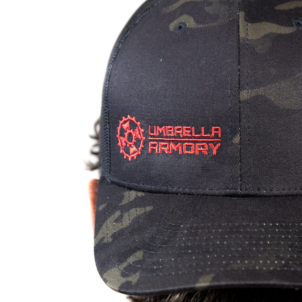 UA Multicam black trucker hat
