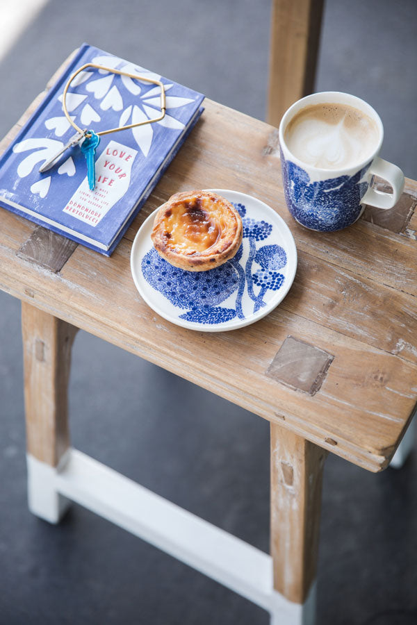 image of blue book with blue cup and saucer