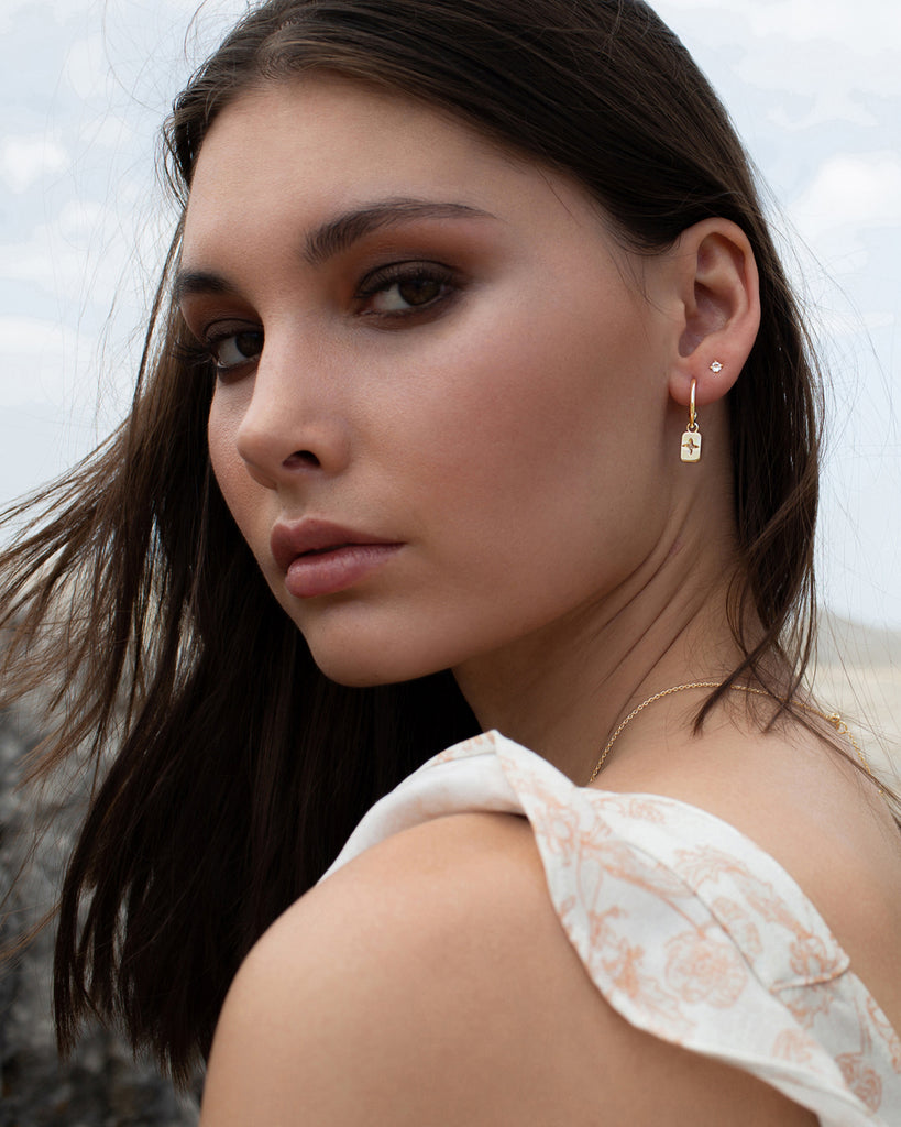Murkani Desert Flower Rectangle Hoop Earrings With White Topaz In 18 KT Yellow Gold Plate