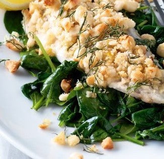 Macadamia-crusted tilapia with lemon spinach