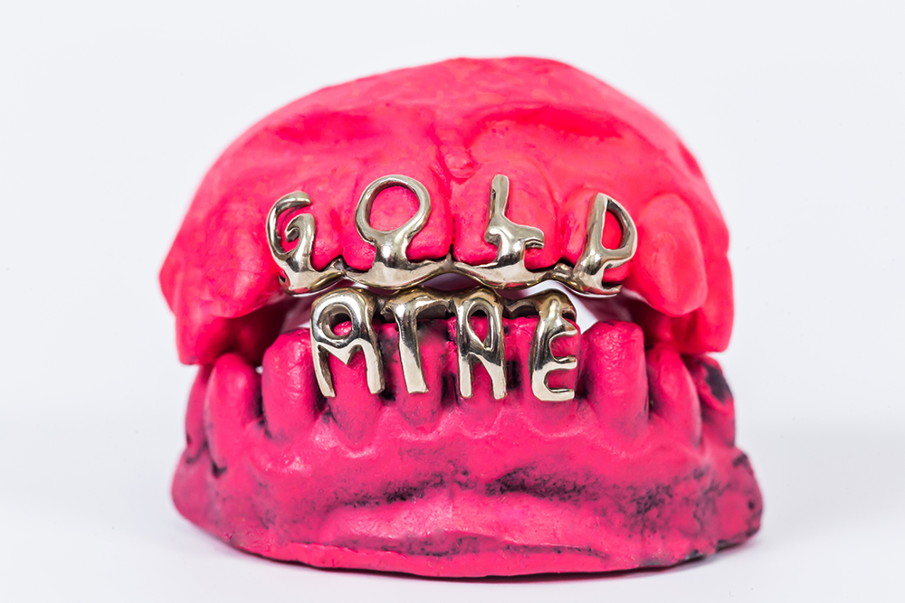 GoldMine letters teeth grillz
