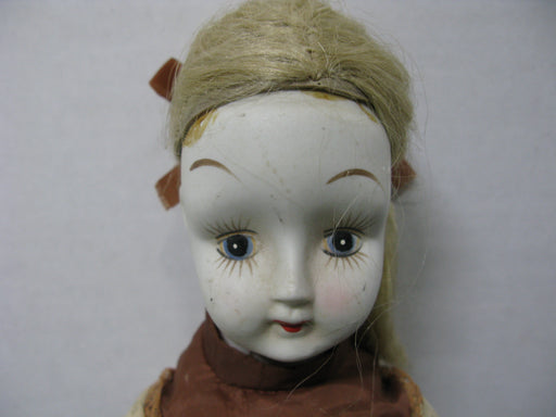 Porcelain Doll with Beige Dress