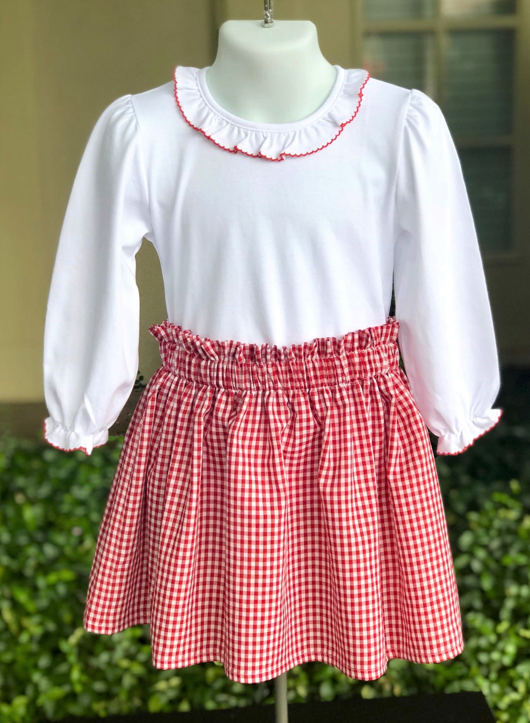 Ruffle collar blouse with red picot trim