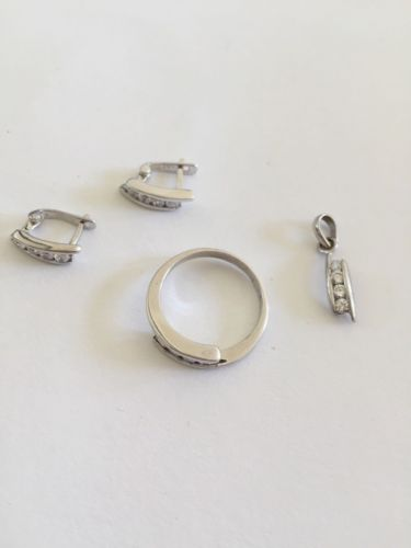 Jewelry set of matching CZ ring, earrings, pendant in 10k white Gold