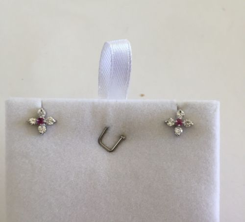 Jewelry set of matching small ruby ring, earrings, pendant in 10k white Gold