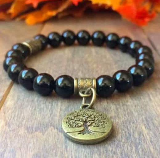 black tourmaline chakra bracelet, product picture of chakra bracelet, chakra bracelet with gold metal, metal pendant and black chakra stone bracelet, chakra bracelets with black beads
