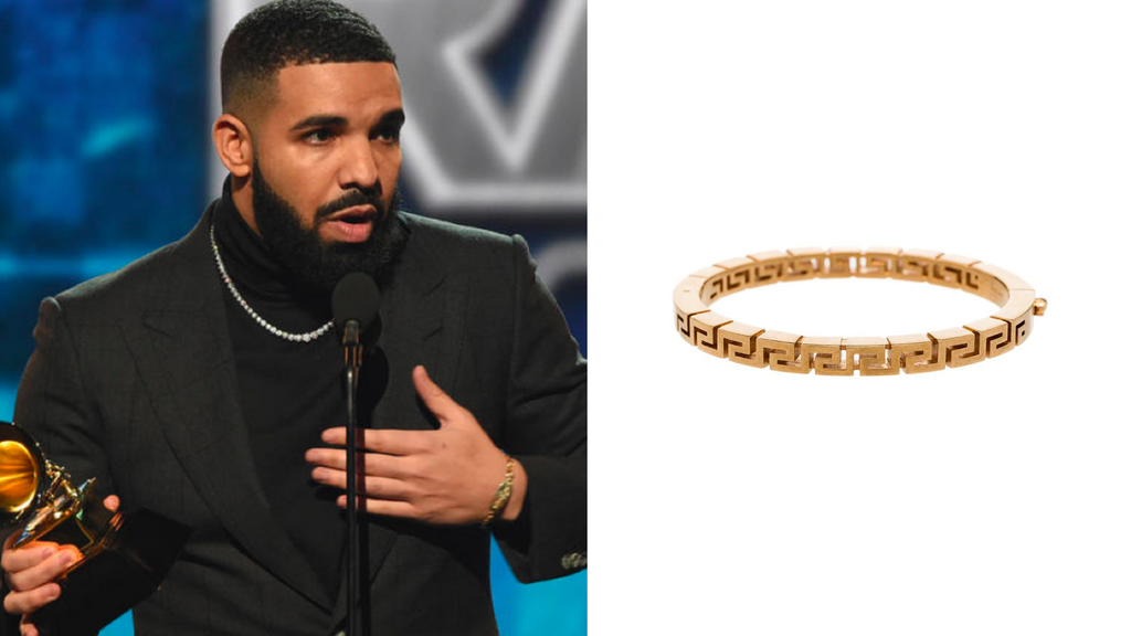 celebrity drake wearing gold chain bracelet with silver chain necklace