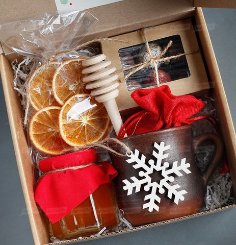 the perfect christmas present for a friend is a simple christmas box with christmas mug and other christmas gifts