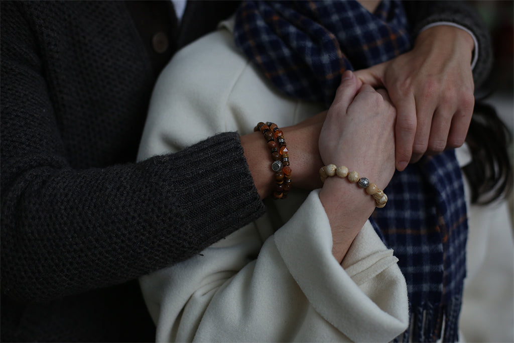 a couple with matching couple bracelets. Couple bracelets that maintain long distance relationships. different types of beaded bracelets for couples as relationship bracelets