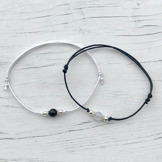 couple bracelets in black and white, image of couple bracelets for matching couples, relationship bracelets for couples with beads, beads with bracelets in couple matching style, couple band bracelets