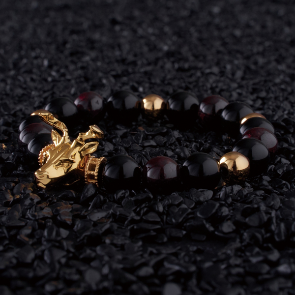 The Gold Deer bracelet idea originated from Milwaukee. It is a masculine figure in the wild forest. Gold beaded bracelet with obsidian and tiger eye bracelet crystal uplifts inner strength and absorbs negativity. The custom Gold Deer bracelet with gold plated beads and tiger eye bracelet and obsidian crystals are a great men's bracelet to collect.