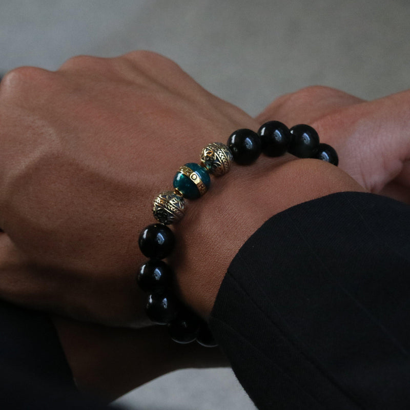 obsidian, obsidian bracelet, black bracelet, black beaded bracelet, obsidian bracelet, obsidian stone, obsidian meaning, obsidian stone bracelet, obsidian black stone, men stone bracelet, men bracelet, bracelet for men, beaded bracelets, mens accessories, men beaded bracelets, black obsidian, obsidian crystal, obsidian jewelry, mens black bead bracelet, black bead bracelet, black obsidian bracelet, azuro republic, silver bracelet, gold bracelet, gold bead, brown obsidian, enamel, gold enamel, turquoise