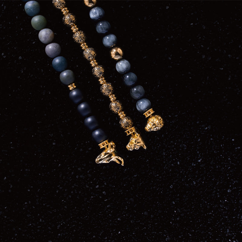 Gold lion bracelet is a clip bracelet mixing with Tiger Eye crystal. This men's beaded bracelet is a sophisticated handcrafted bracelet with a masculine gold lion charm. Tiger eye crystal attracts positivity.  If you are looking for a custom men's beaded bracelet, you can learn more from our gemstone crystal beaded bracelet collection.