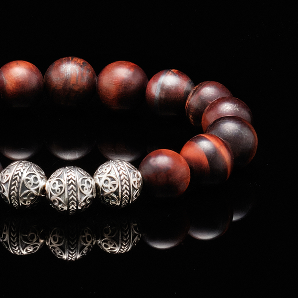 Azuro Republic Matt Red Tiger Eye Bracelet is a solar gemstone of vitality, action, and success. It stimulates the root chakra, sacral chakra, and solar plexus chakra to help you take action to achieve your dreams while remaining grounded, centered and calm.