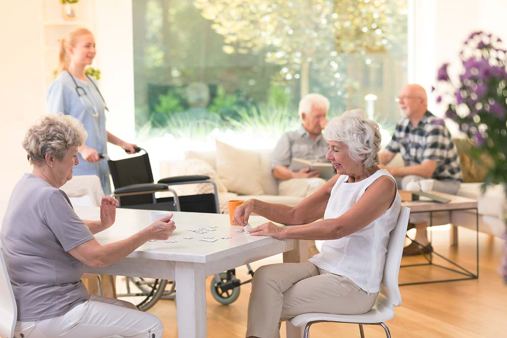 Happy aged care residents enjoying social service environment