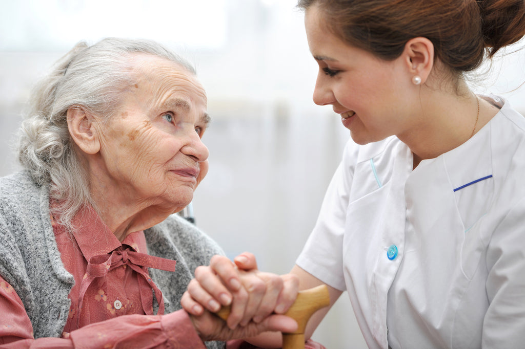 woman and nurse in aged care facility