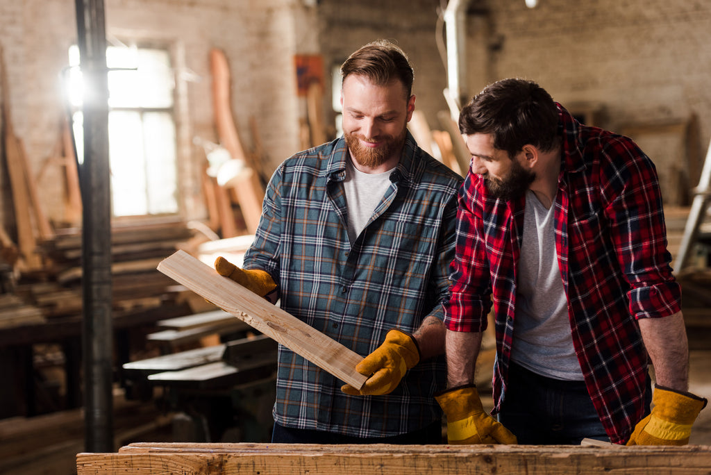 carpenters choosing quality materials for furniture manufacturing