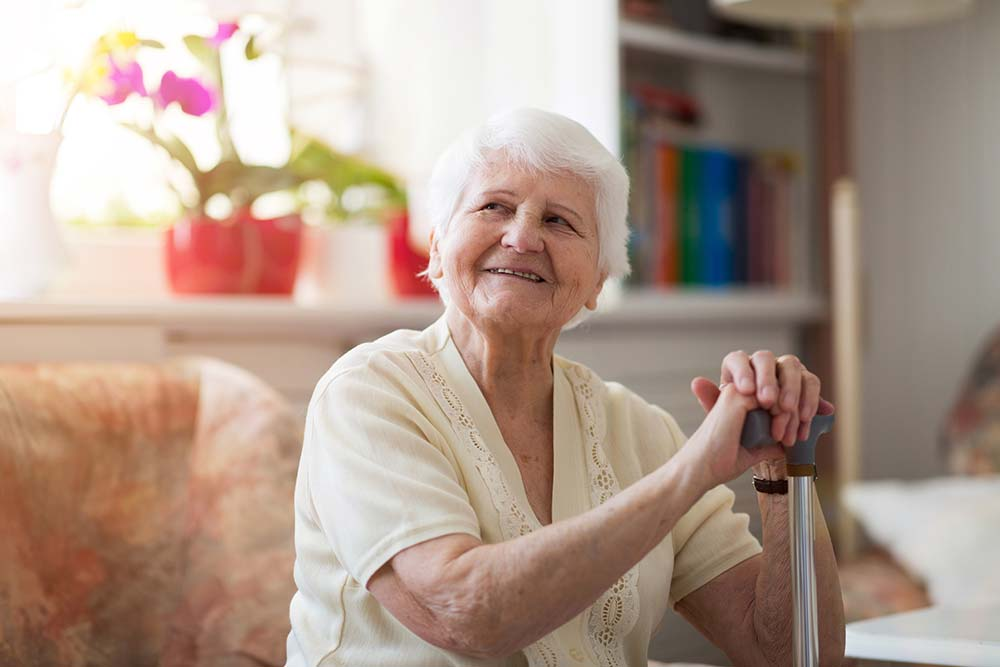 Happy elderly woman in aged care home
