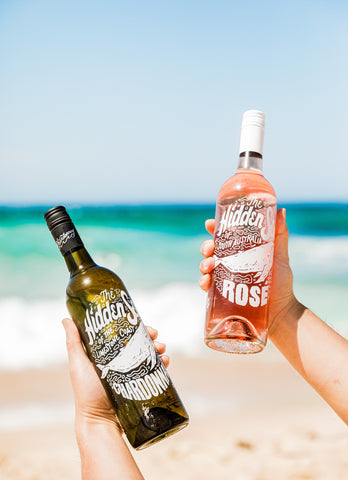 Two bottles of wine at the beach