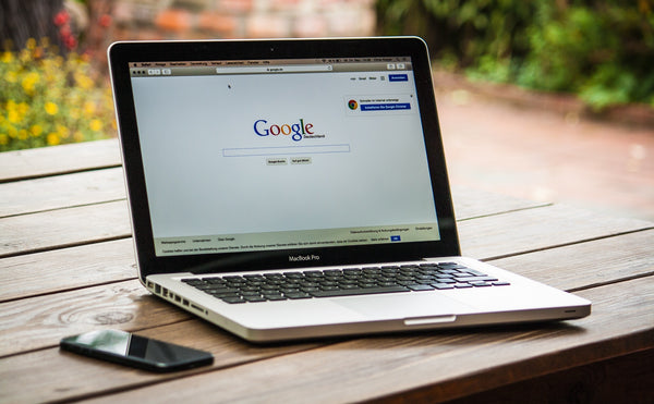 A laptop with Google Search Engine page