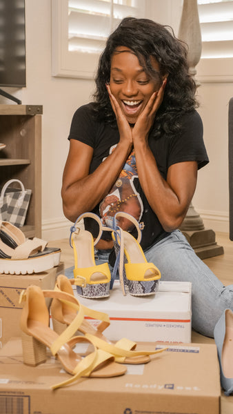 A woman happily looking at shoes