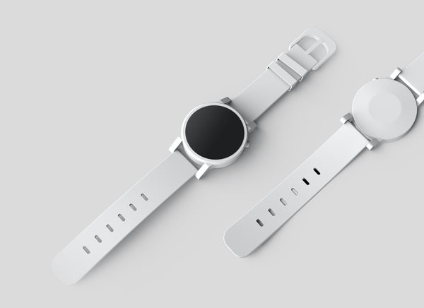 Image of two wristwatches with white straps