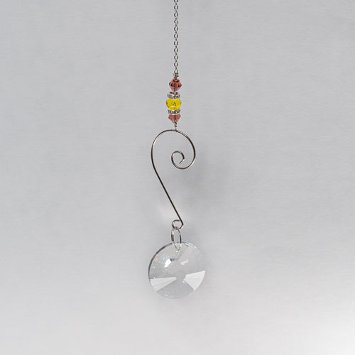 Suncatcher w/ Yellow and plum beading.