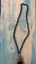 Black Beaded Necklace with Leather Tassels