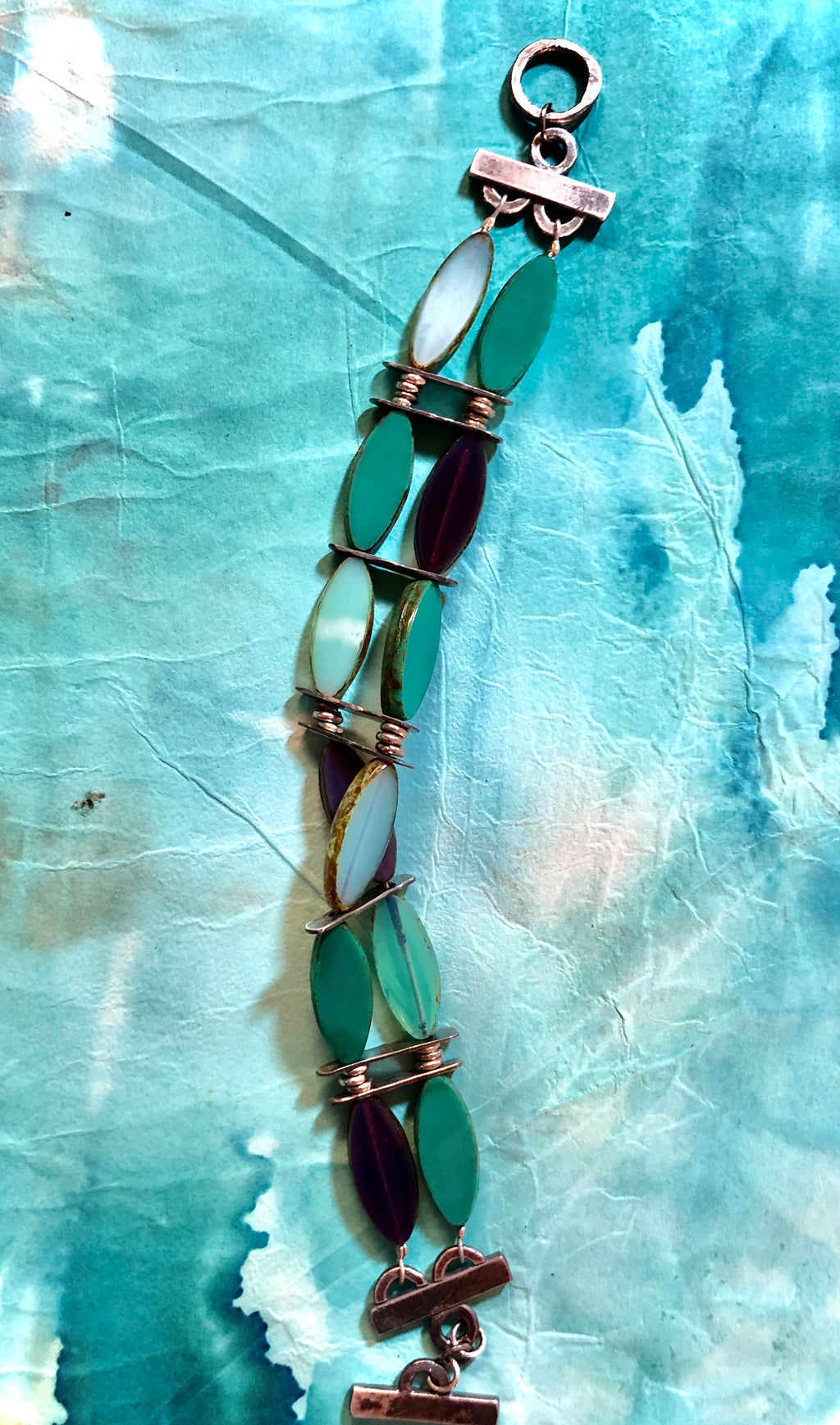 Eye Catcher!  Aqua and purple vintage inspired glass beads accented by hand crafted silver.