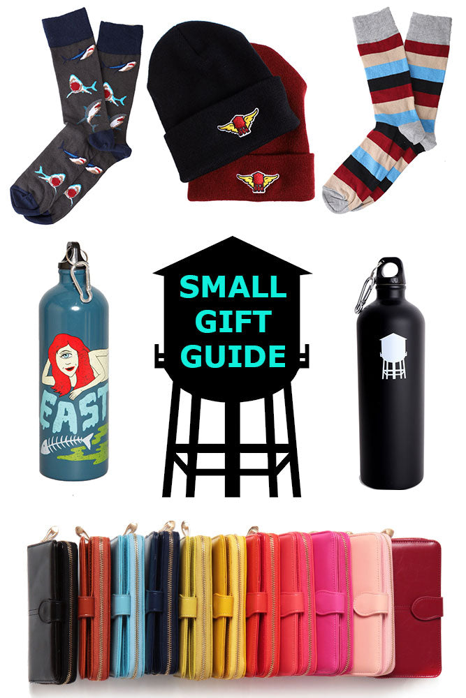 collection of small gifts arranged around a black watertower , includes socks, hats, water bottles and wallets.