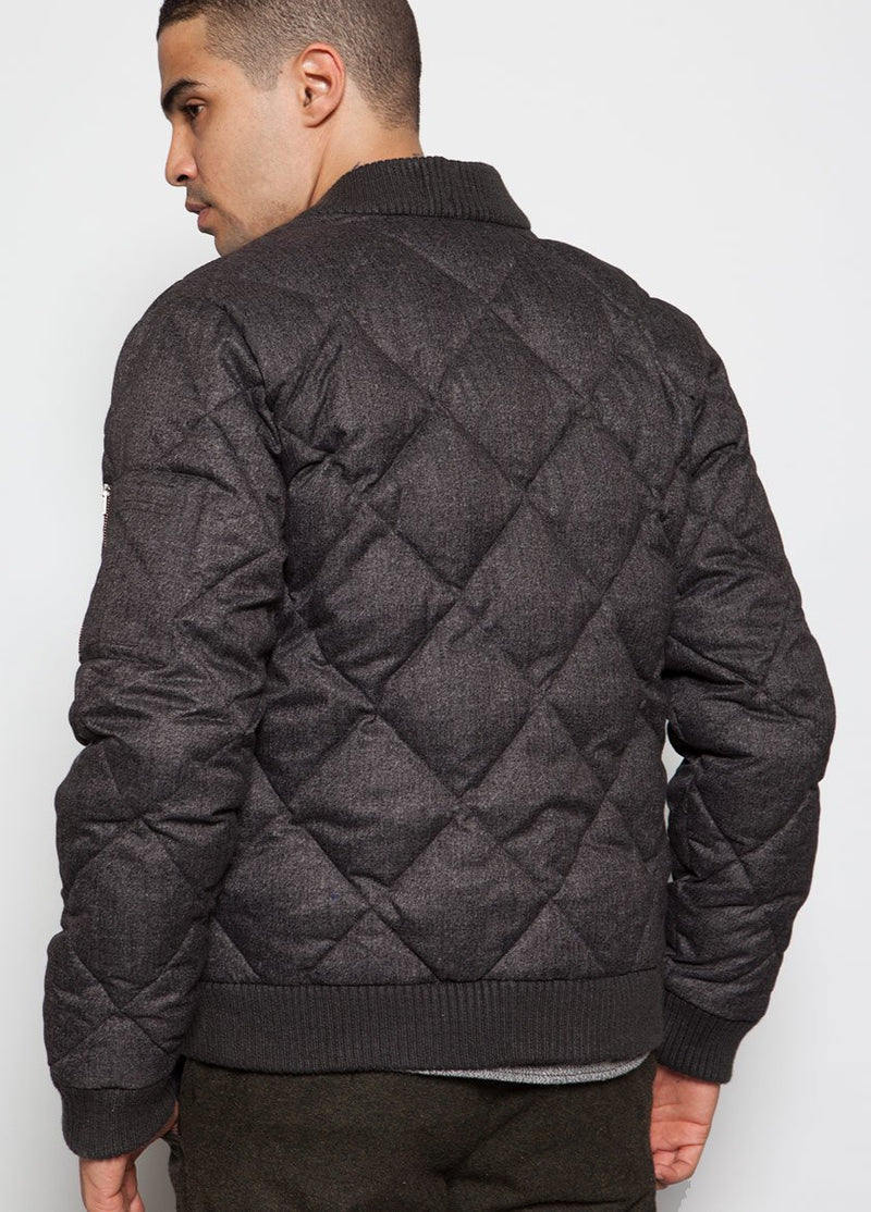 MALE MODEL IN QUILTED CHARCOAL BOMBER COAT, VIEW OF THE BACK