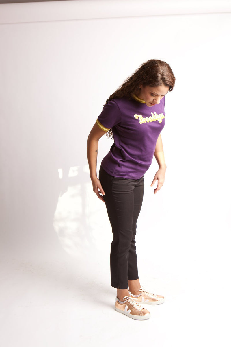 SIDE VIEW OF MODEL LOOKING DOWN IN BLACKBERRY RADICAL RIB T-SHIRT